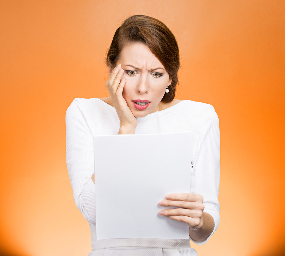 Employer Flexible Texas Business Owners Keep an Eye on Inflation Woman Looking at Paper Shocked Orange Background