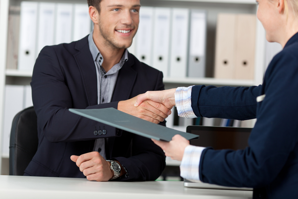 Employer Flexible Talent Review Best Practices Man Shaking Hands with Business Person