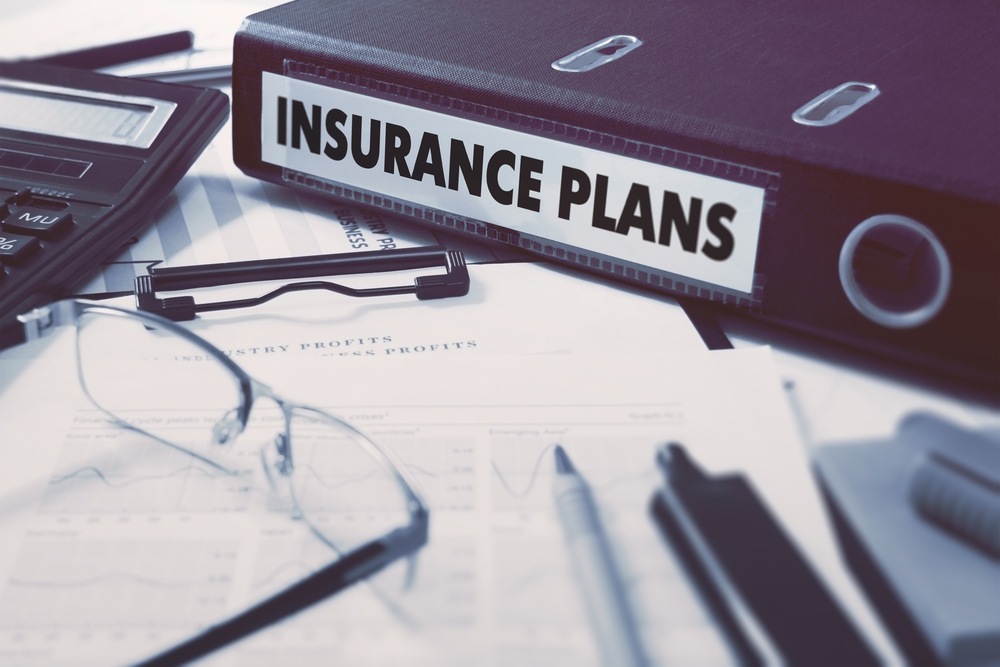 black binder holding insurance plans
