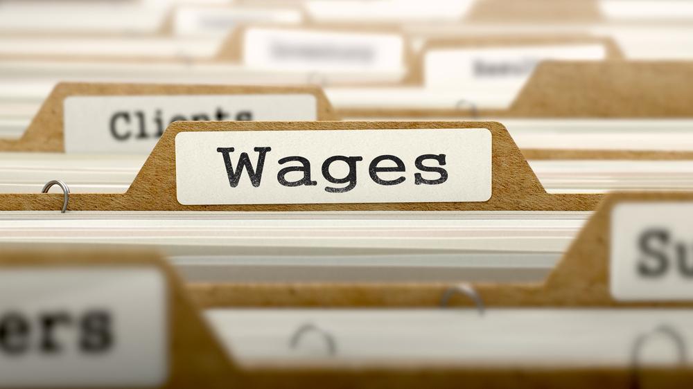 "file folder labeled ""wages"""